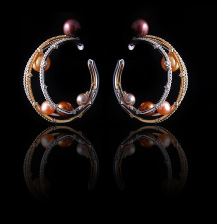 jewelle: diamond pearl earrings with reflection
