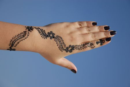 bangles hand: a design on hands against a blue background Stock Photo