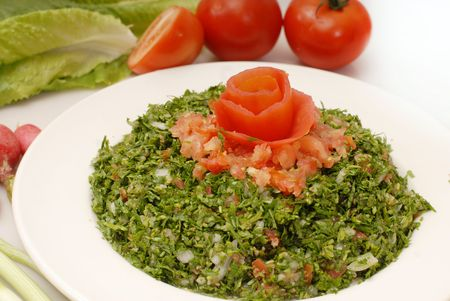 lebanese: Color rich Tabbouleh salad and middle eastern food  Stock Photo