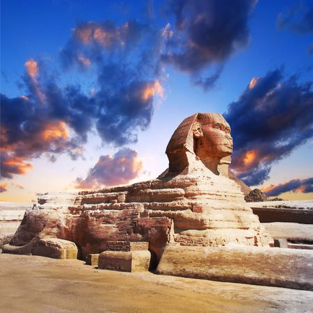 giza:  Egyptian sphinx and pyramid on sunset