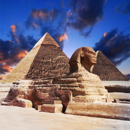 ruin:  Egyptian sphinx and pyramid on sunset