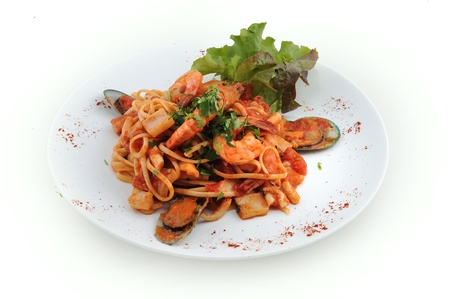 Italian pasta with seafood on a plate photo