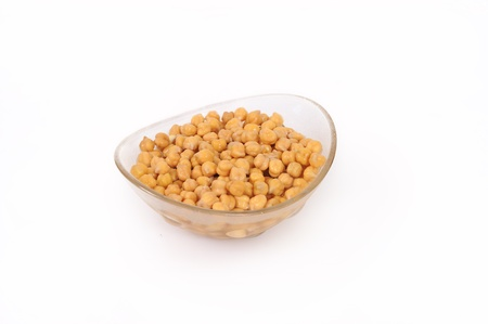 Close up view of chickpea in bowl on white background photo