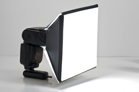 portable sb flash diffused with a softbox Stock Photo - 9686312
