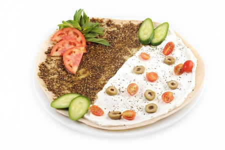 foodie: lebanese food of manakish of zaatar and cheese with veggies on top