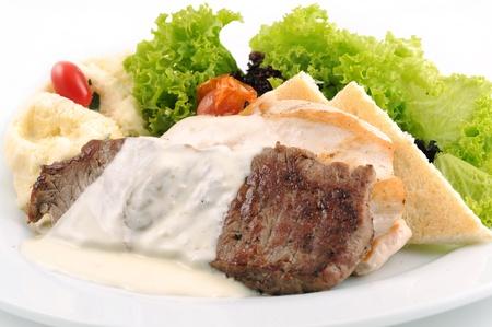 grilled fillet steak and vegetables photo