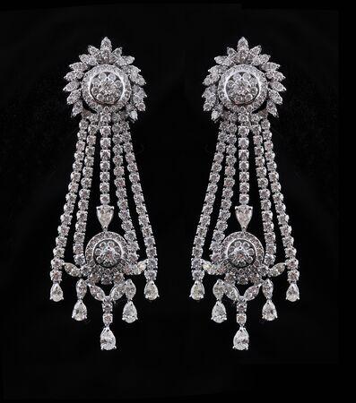 diamond jewellery: diamond earings with reflection