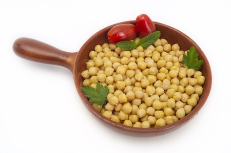 chickpea: Close up view of chickpea in bowl on white background Stock Photo