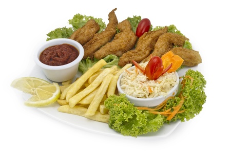 suppertime: crispy chicken with platter of vegetables and dip on a white background Stock Photo