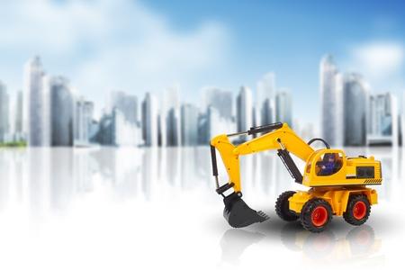 excavator against a cityscape  photo