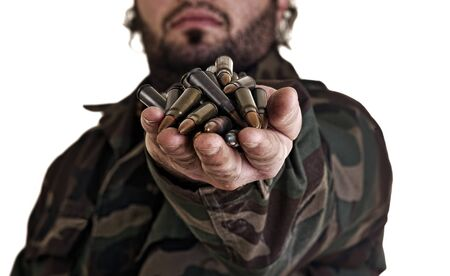 Grungy mood of a warrior in the army holding bullets Stock Photo - 12651840