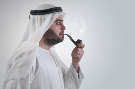 arabian business man smoking pipe Stock Photo - 12651837