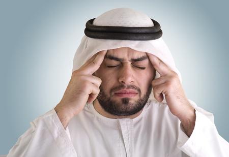 arabian man having a headache Stock Photo - 12651838