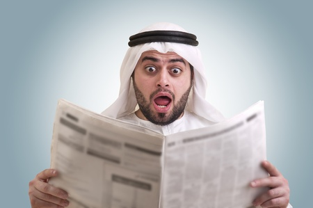 ksa: arabian businessman shocked while reading newspaper Stock Photo