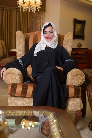 arabian lady with hijab relaxing at her home  photo