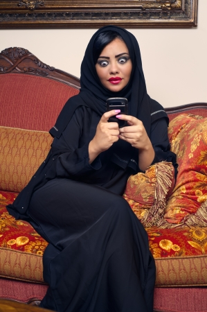 arabian lady with hijab having fun while chatting
