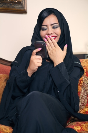 arabian lady with hijab having fun while chatting  photo