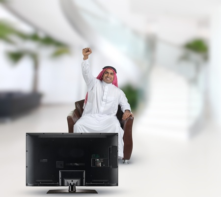 arabian man watching TV and reacting Stock Photo - 13659248