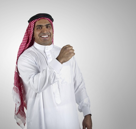 Portrait of a successful arabian business man smiling  photo