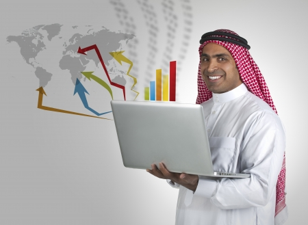successful arabian business man performing stock works on laptop  photo