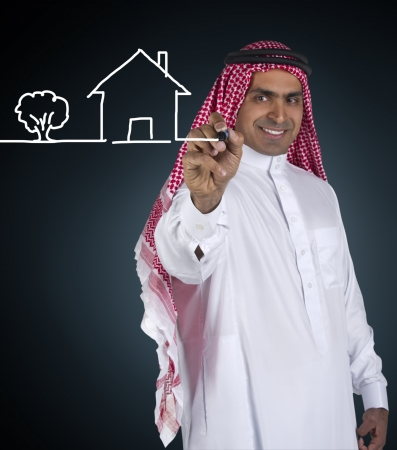arabian business man sketching a house  photo