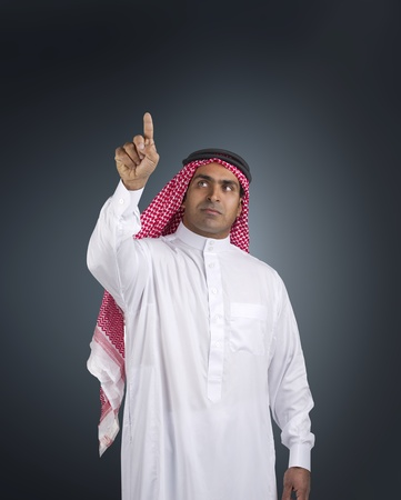 traditional arabian man in a business executive scene  photo