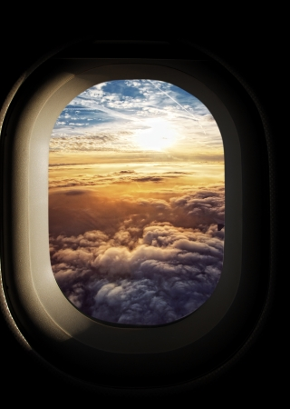 airplane window: heavenly sky seen through the windows of an airplane  Stock Photo