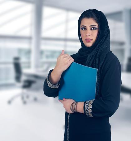 arabic woman: islamic executive in a business presentation scene
