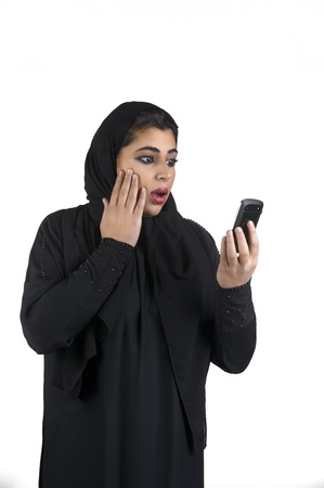 KSA: Arabian girl wearing hijab with a surprised expression