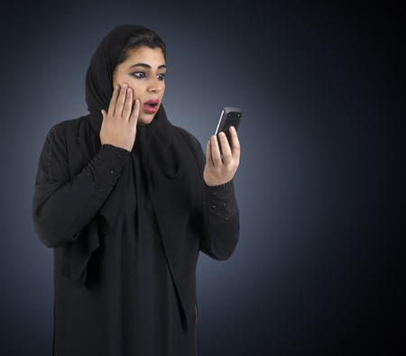 Arabian girl wearing hijab with a surprised expression  photo