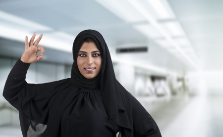 Perfect arabian business woman showing OK hand sign  photo