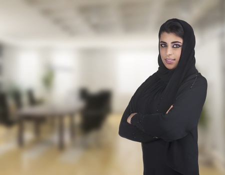 arabian business executive woman wearing hijab posing in office  photo