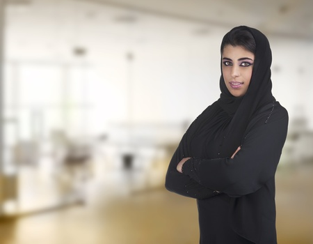 arabian business executive woman wearing hijab posing in office Stock Photo - 13658917