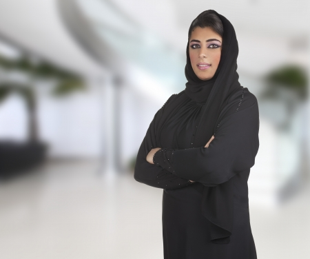 saudi: arabian business executive woman wearing hijab posing in office
