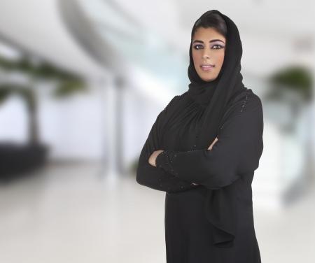 arabian business executive woman wearing hijab posing in office Stock Photo