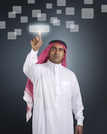 saudi: arabian businessman pressing a touchscreen button