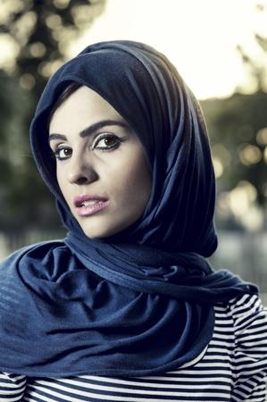 veiled: beautiful arabian lady wearing traditional islamic outfit  Stock Photo