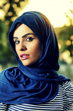purdah: beautiful arabian lady wearing hijab  Stock Photo