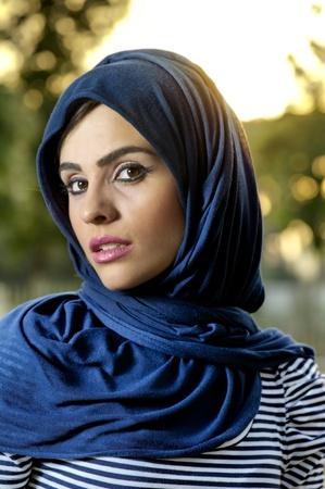 mystery of faith: beautiful arabian lady wearing hijab  Stock Photo