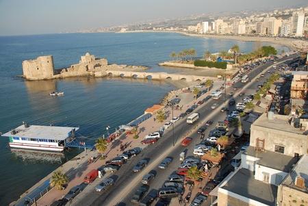 sidon , lebanon showing crusader sea castle   tourist boats  photo