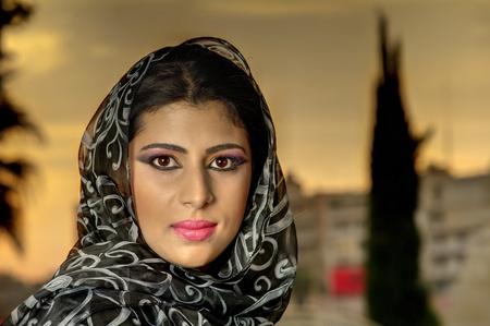 arabic woman: beautiful arabian lady wearing traditional islamic outfit  Stock Photo