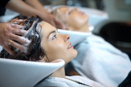 Beautiful woman getting a hair wash  In a hair salon
