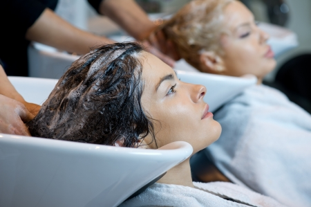 Beautiful woman getting a hair wash  In a hair salon  Stock Photo - 13651974