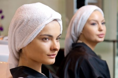 beautiful woman with towel on her head after washing her hair  Stock Photo