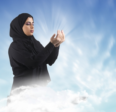 islamic girl wearing hijab and praying in a holy composition