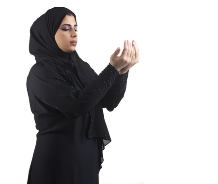 cultural and ethnic clothing: islamic woman wearing hijab   praying