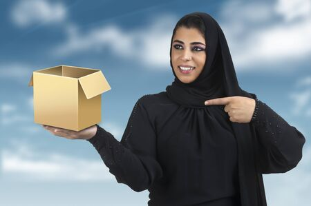 islamic lady holding an empty blank box with space for text  photo