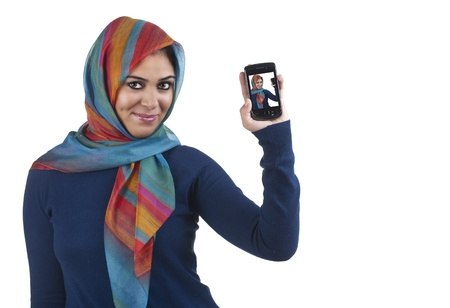 beautiful stylish islamic girl wearing hijab on the phone  Stock Photo - 13658915