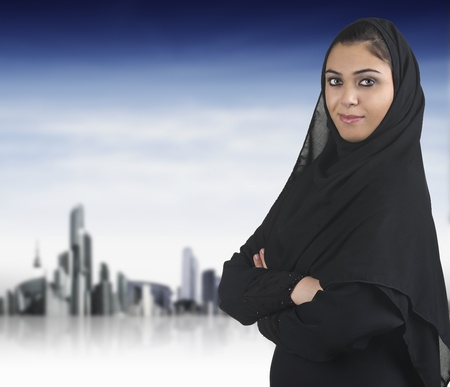 veiled: professional islamic woman wearing hijab against a cityscape