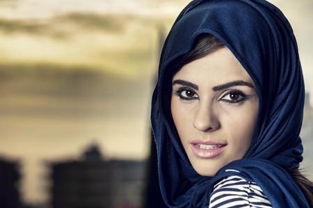 beautiful arabian lady wearing traditional islamic outfit  photo